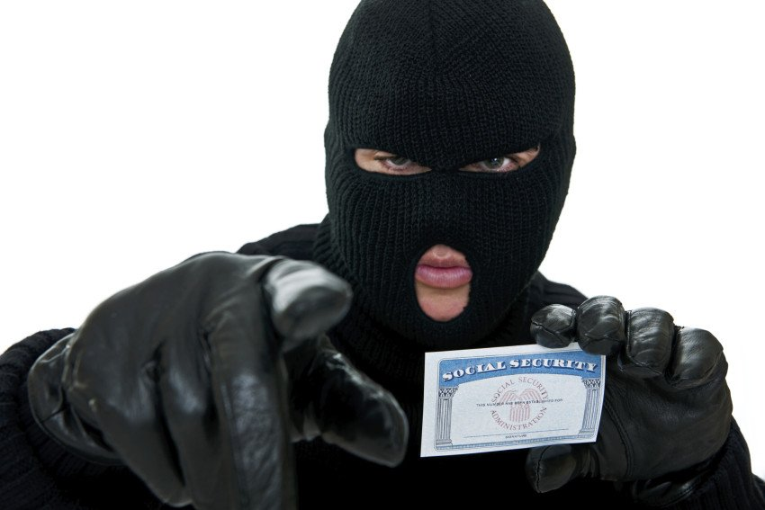"""Burglar Stealing ID"", via Stockphoto4U, ThinkStock."