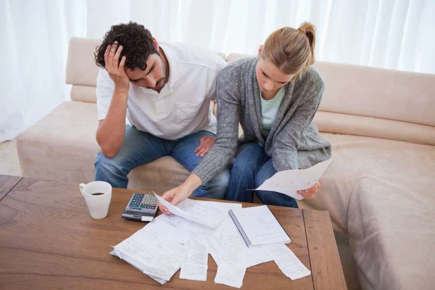 """Depressed Couple Doing Their Accounting"", via wavebreakmedia, ThinkStock."
