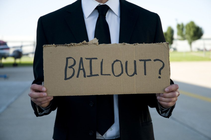 """Businessman Holding a Sign That Says Bailout"", via Taylor Hutchens, ThinkStock."