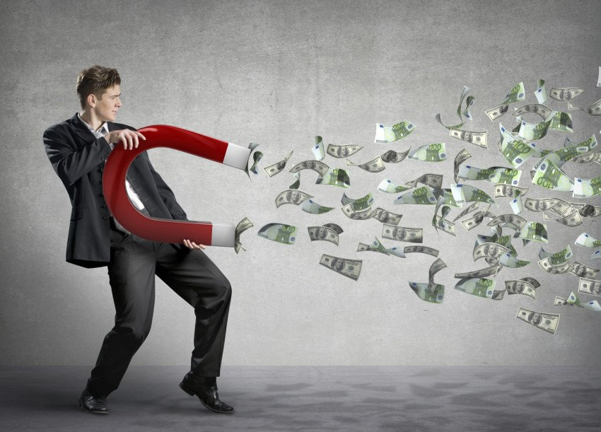"""""""Businessman attracts money with a large magnet"""", via Tijana87, ThinkStock"""