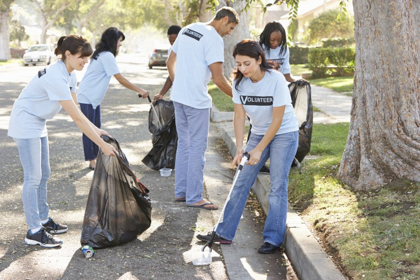 """Team of Volunteers Picking Up Litter in Street"", via Catherine Yeulet, ThinkStock."