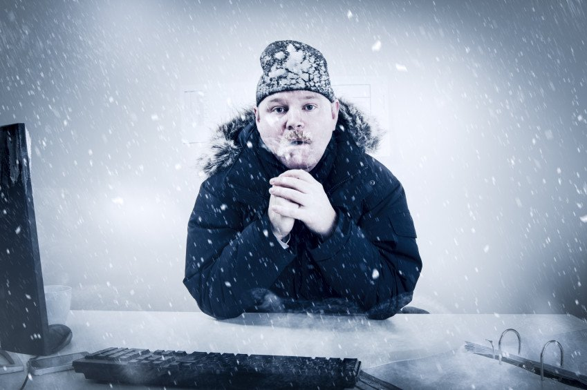 """""""Businessman in a Cold Office with Snow and Ice"""", via kjekol, ThinkStock."""