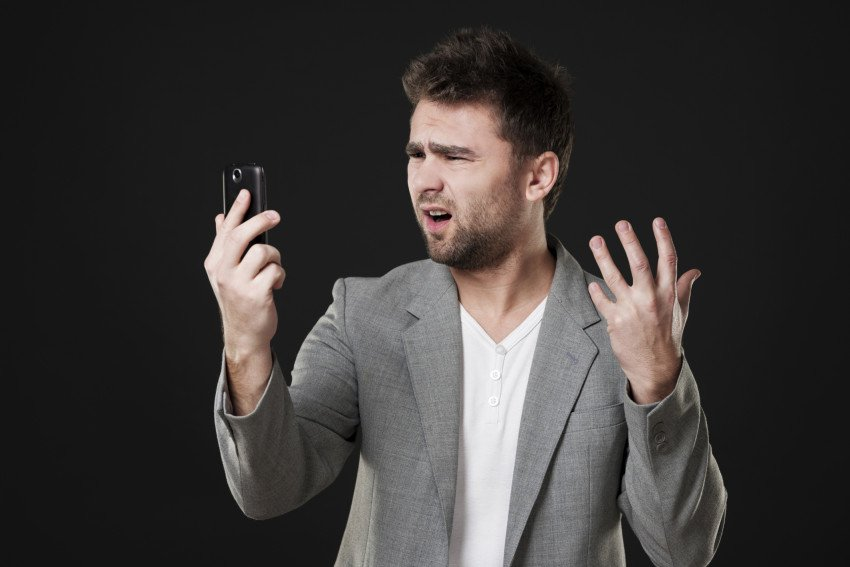 """Frustrated Man With Mobile Phone"">, via Anna Bizoa, ThinkStock."
