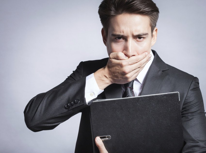 """""""Young Businessman Covering His Mouth"""", via kieferpix, ThinkStock."""