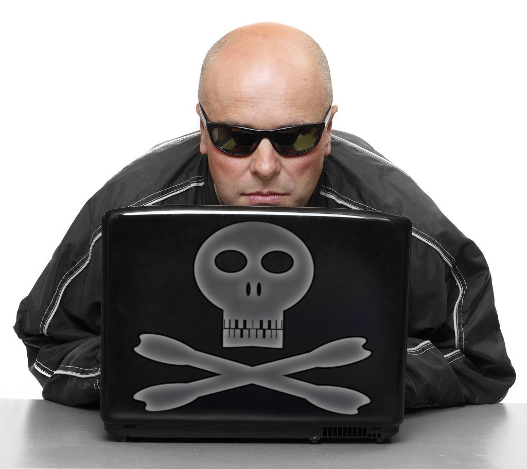 """Dangerous Hacker With Laptop"", via abadonian, ThinkStock."