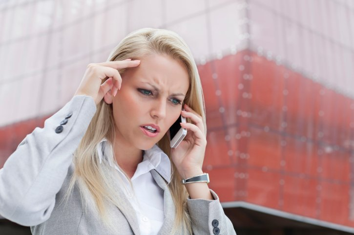 """""""Angry businesswoman on cell phone"""" via moodboard on ThinkStock"""