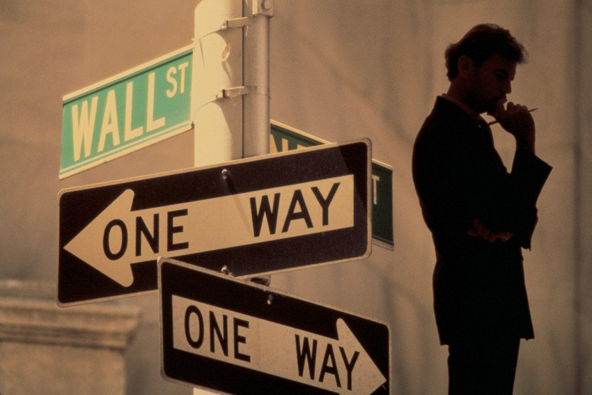 """Silhouette of Man with One Way Signs on Wall Street"", via Comstock, ThinkStock."