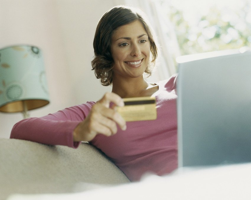"""Woman Using Her Bank Card Online"", via Digital Vision, ThinkStock."