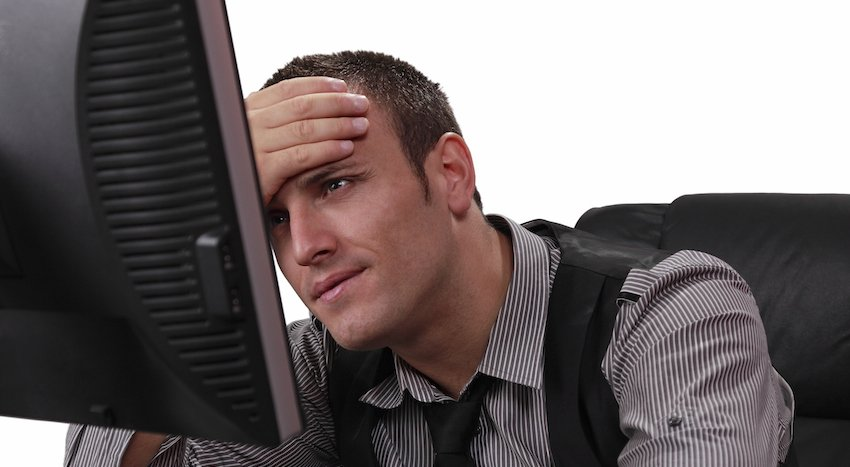 """Unhappy Young Man In Front Of Computer"" via Razvan on Thinkstock"