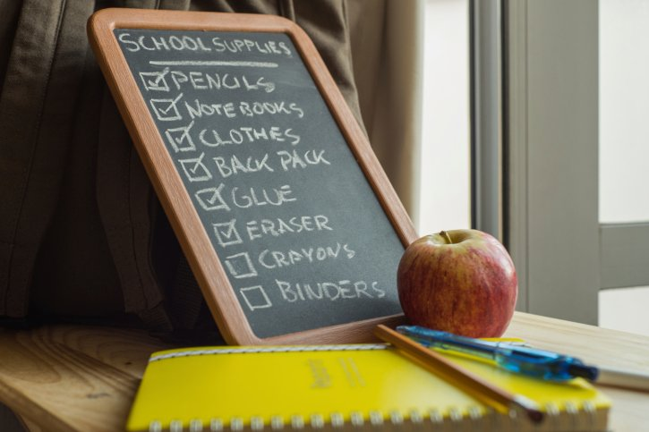 School Supply List with School Supplies and an Apple