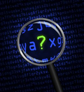 Question Mark revealed in computer code through a magnifying glass